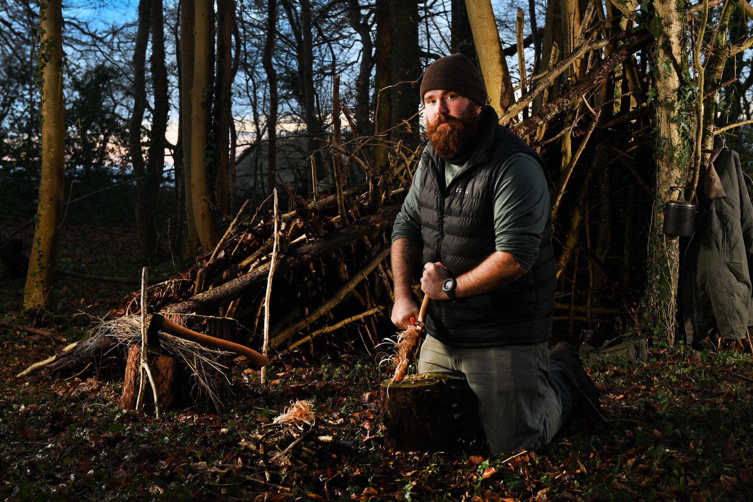 A man practicing bushcraft on our woodland bushcraft course